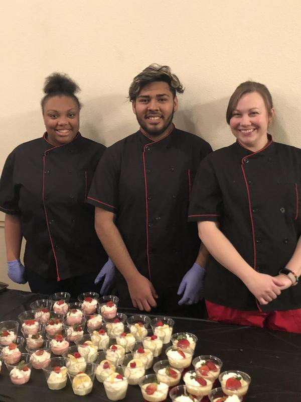 culinary students with desserts