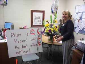 Dr. Hall with flowers on Principals' Day!