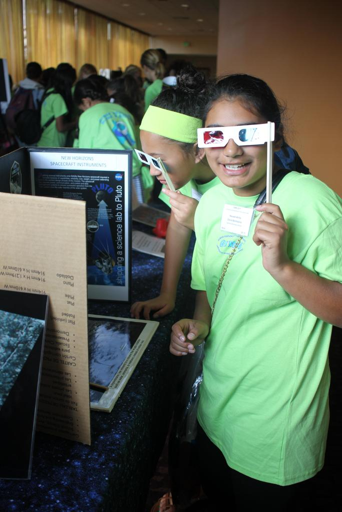 girls looking through 3D glasses