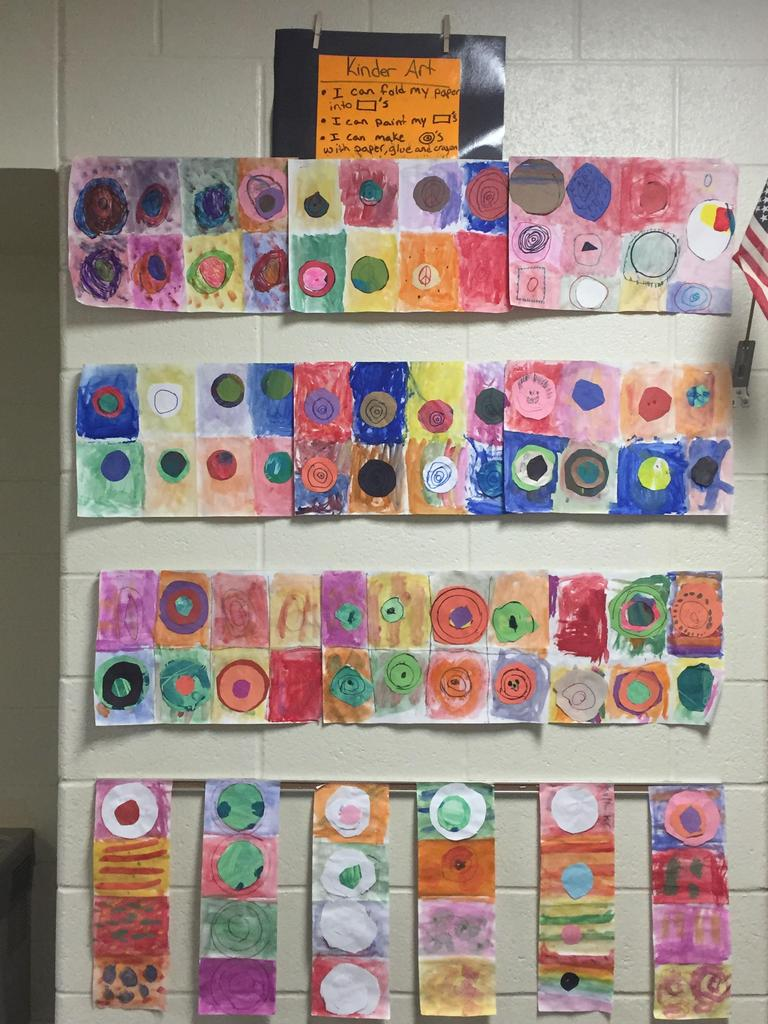 "Kindergarten creates rectangle paintings with concentric circles. ""Look Ms. Warren I can fold my own paper!"""
