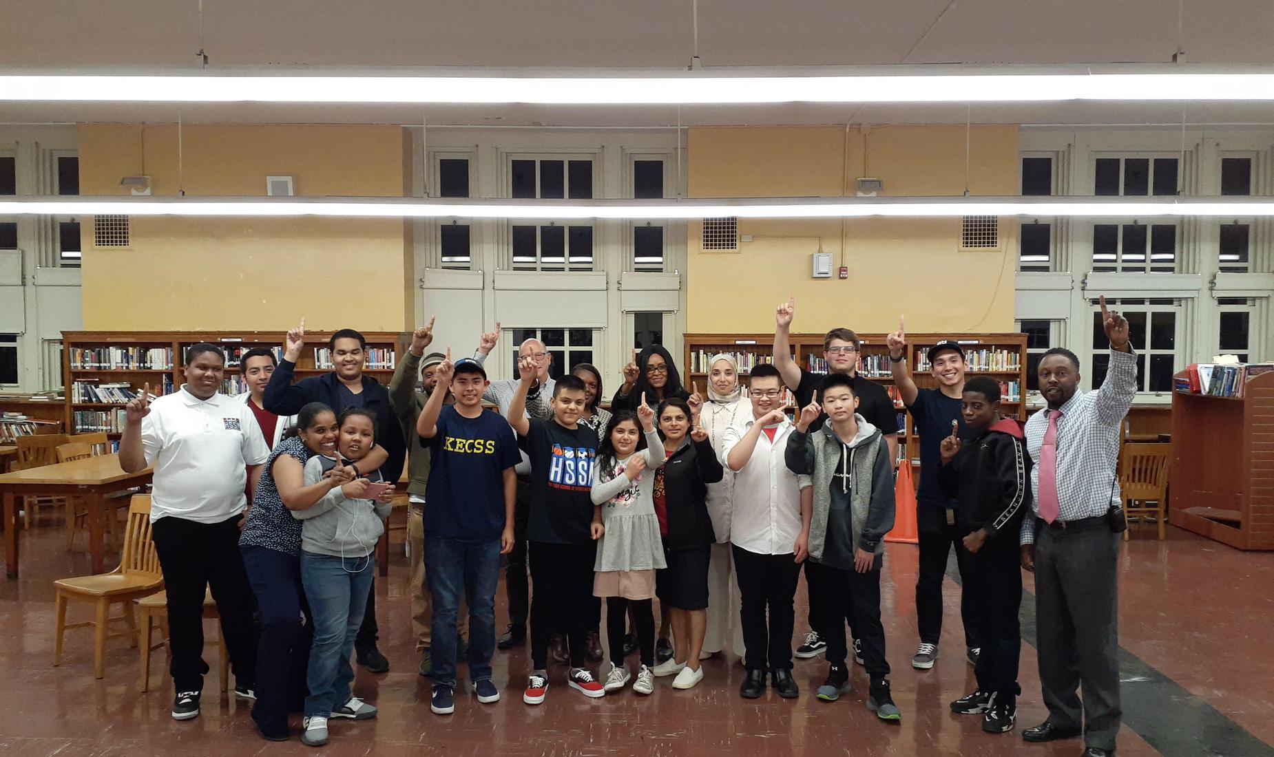 Students holding up #1 finger