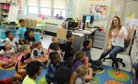 Photo of teacher reading to students in GTE classroom