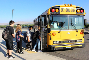 Students loading onto the bus