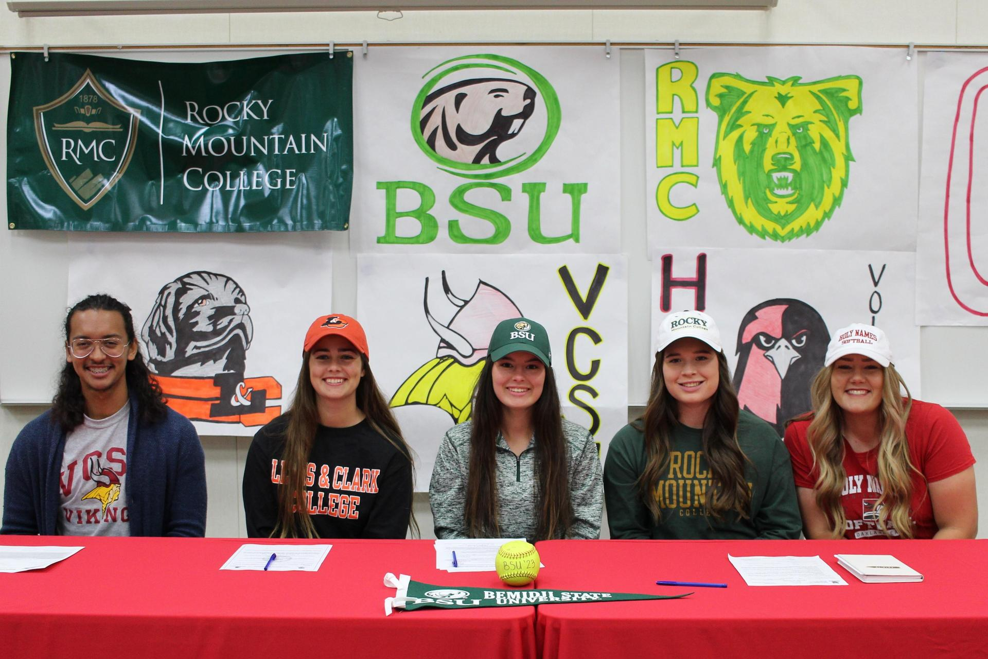 Isaac Salazar, Kylie Hill, Morgan Sewell, Claire Wright and Kelsey Volkmar sign college letters of intent