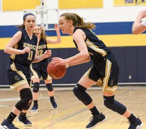 Pic of girls playing basketball
