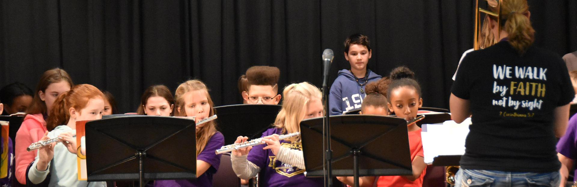 Elementary band performing at elementary chapel