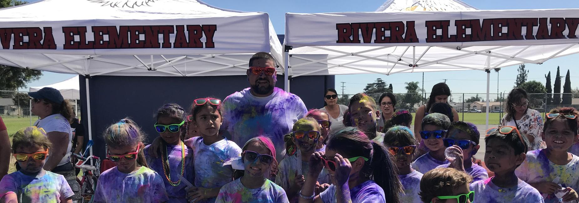 Our Principal with students at our Color Run.