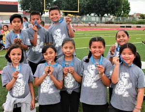 Students celebrate a day at Sierra Vista High School's track and field on May 10, marking their successful completion of Rod Dixon's Kids Marathon Run program that challenges students to run a 26.2-mile marathon over the course of multiple weeks.