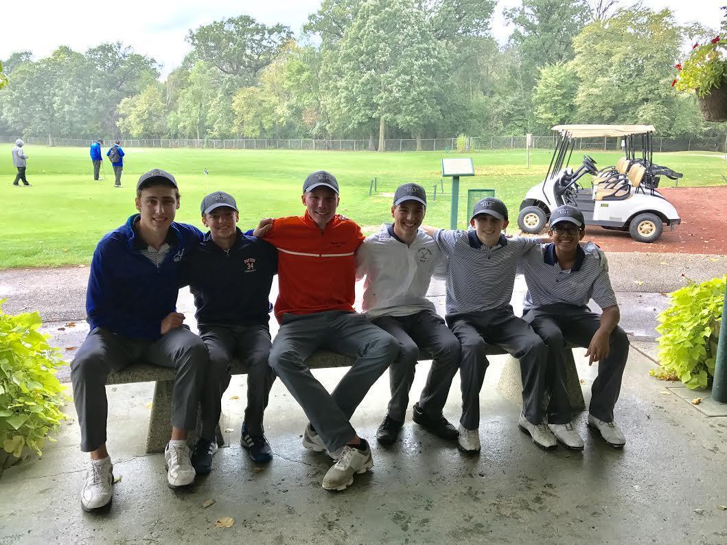 Image Boys Golf Team Sitting on Bench