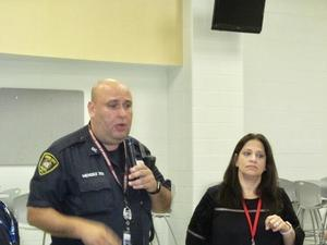 officer mendez with parent liaison Debbie Mendez talking about buylling effects