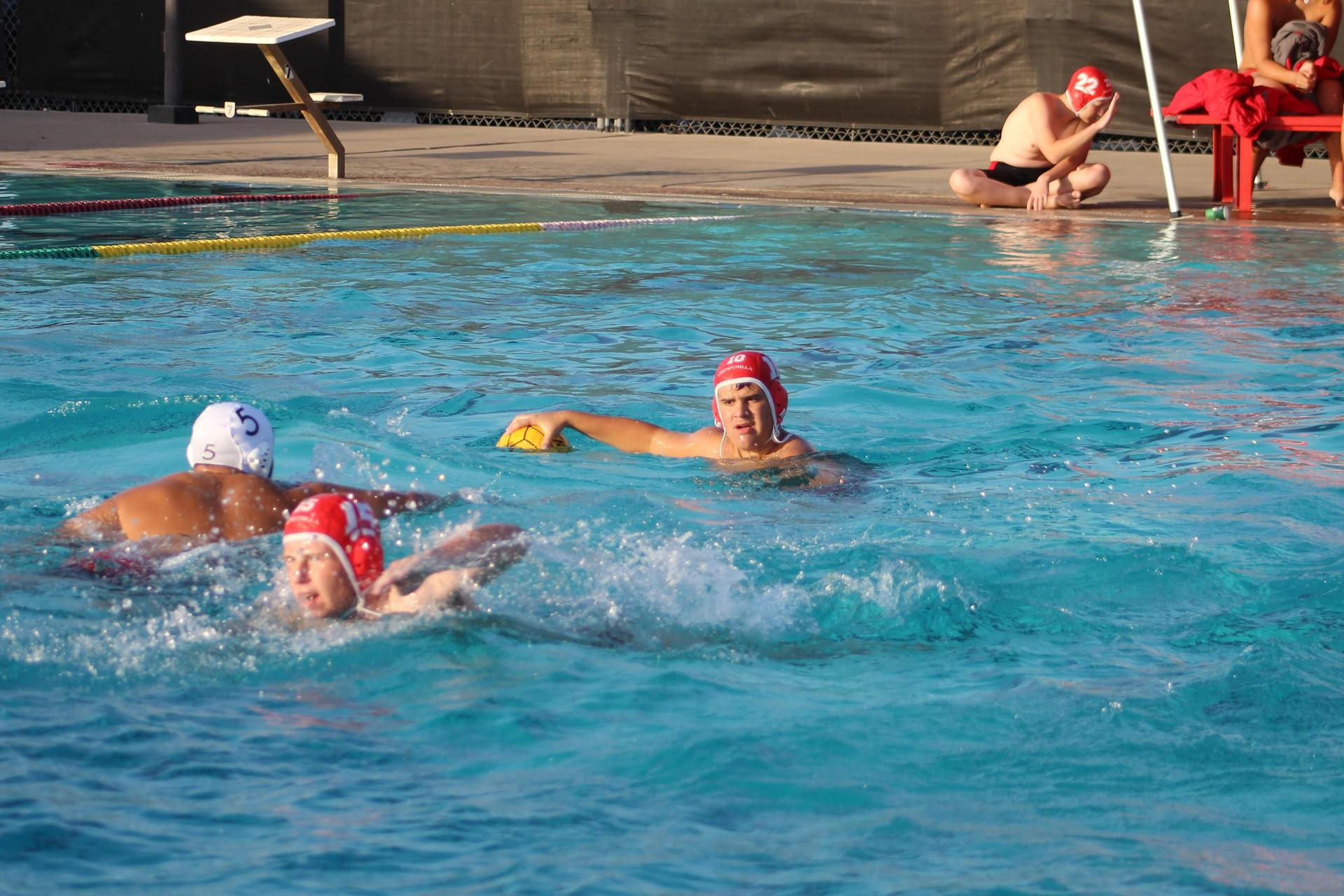 Boys water polo player with the ball