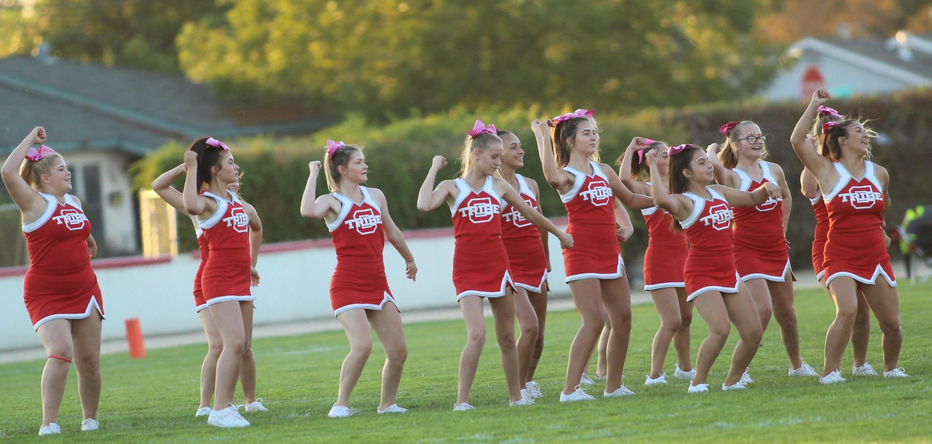 Junior Varsity boys and cheerleaders at the football game against Yosemite