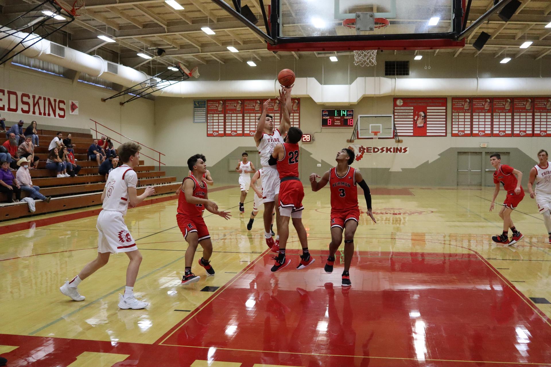 Boys Basketball in action vs. Kerman