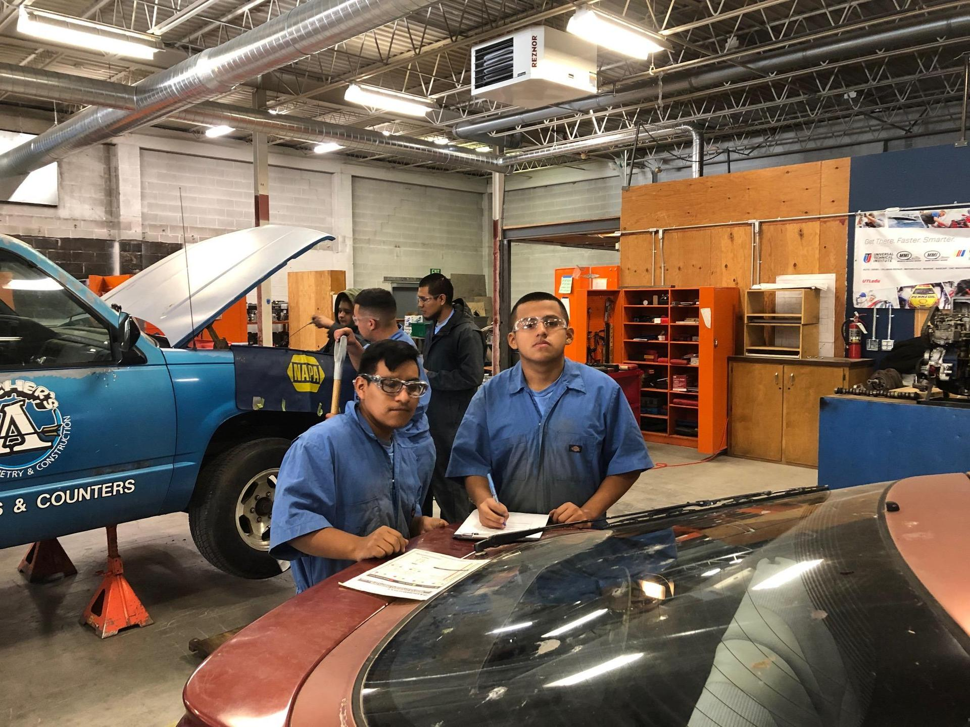 Students performing safety checks on our shop vehicles at our new location.