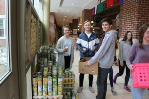 Students pack up donated items.