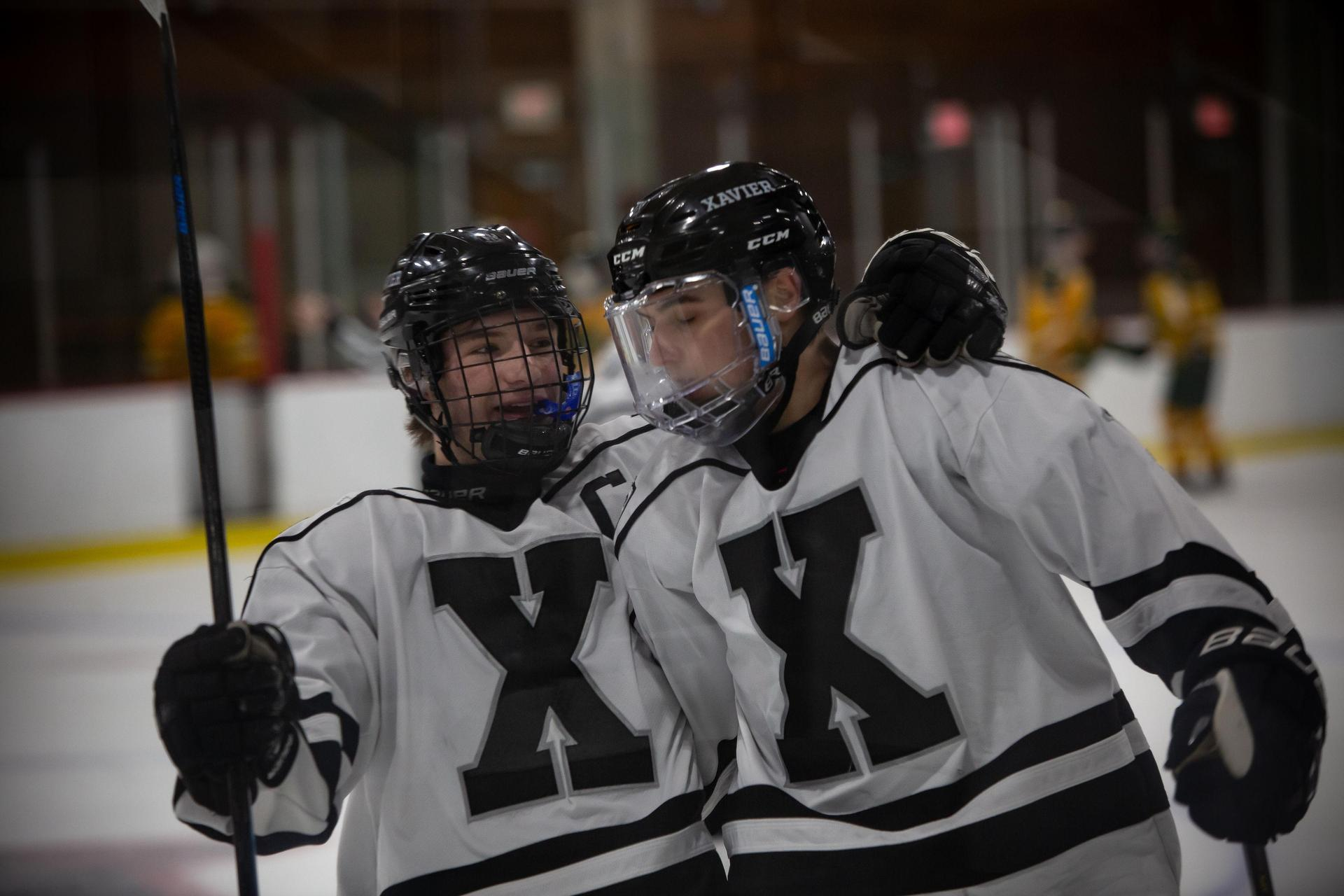 Hockey Players Celebrating at Xavier