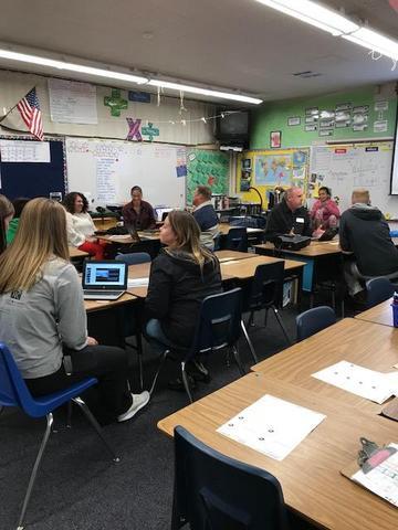 Parents in school classroom