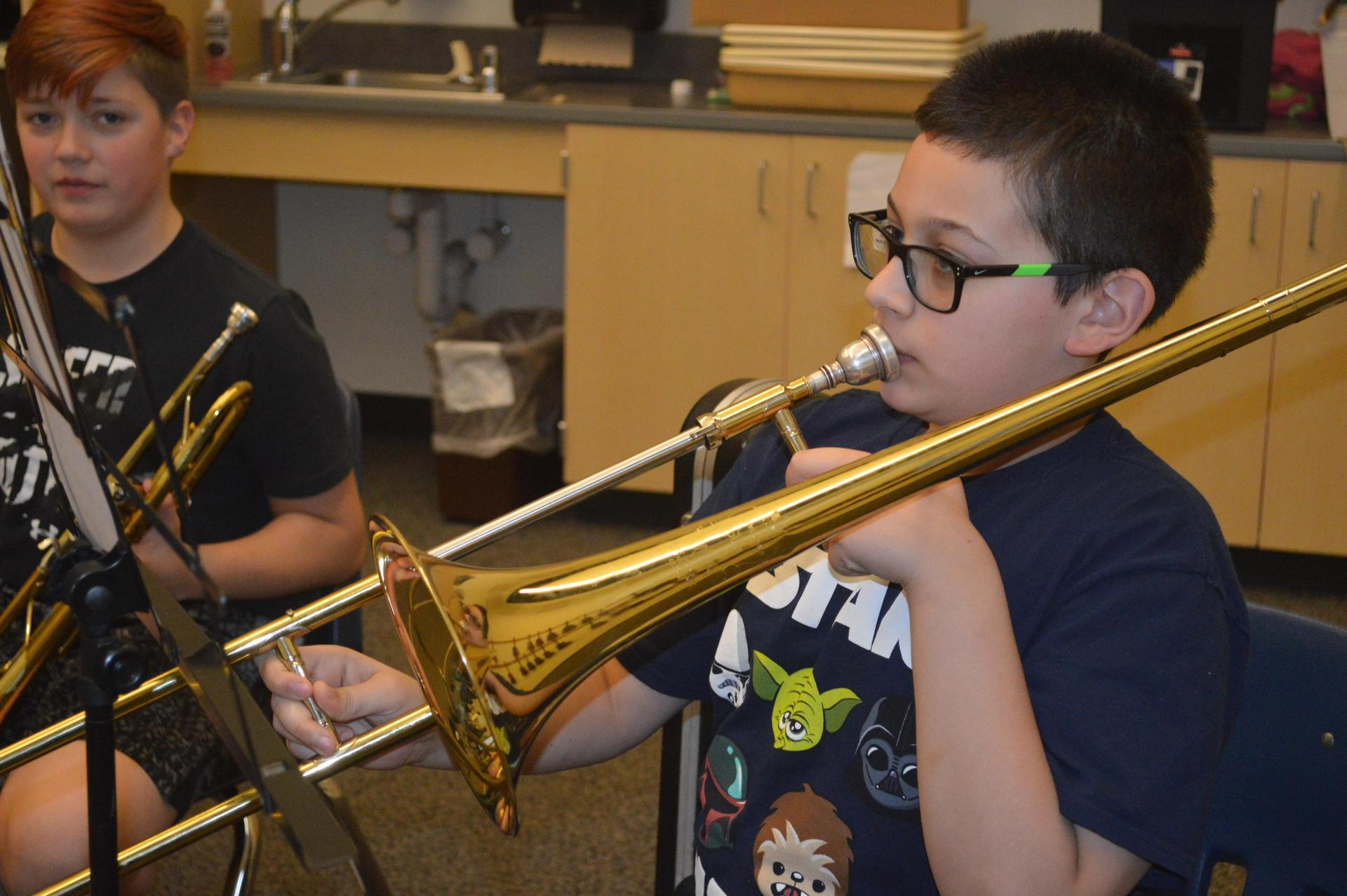 male student playing the trombone