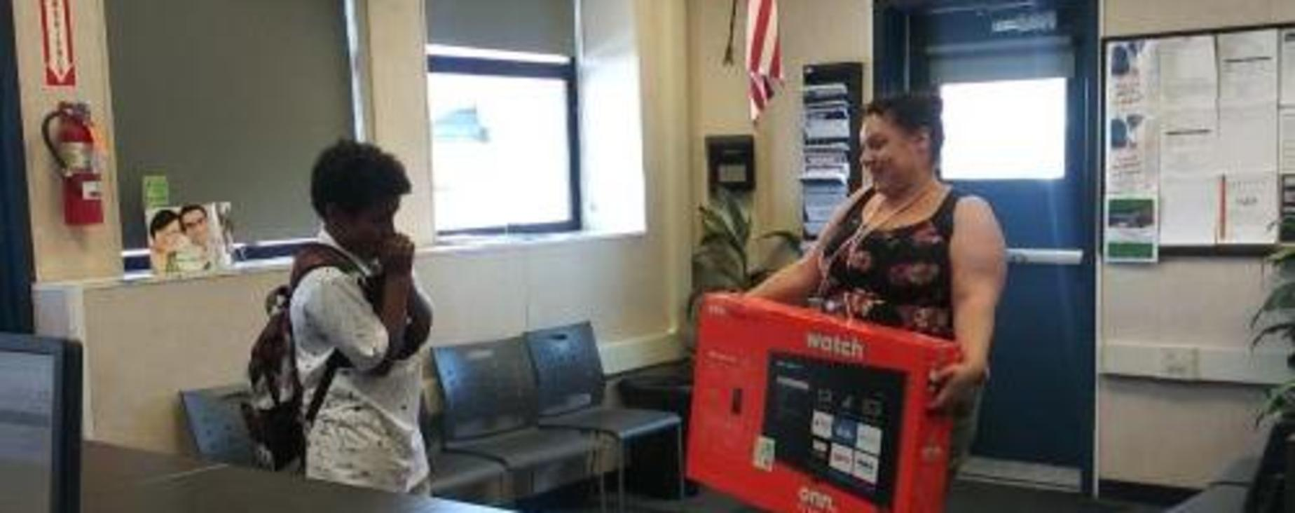 Atendance raffle winner surprised to learn that he won a new smart tv.