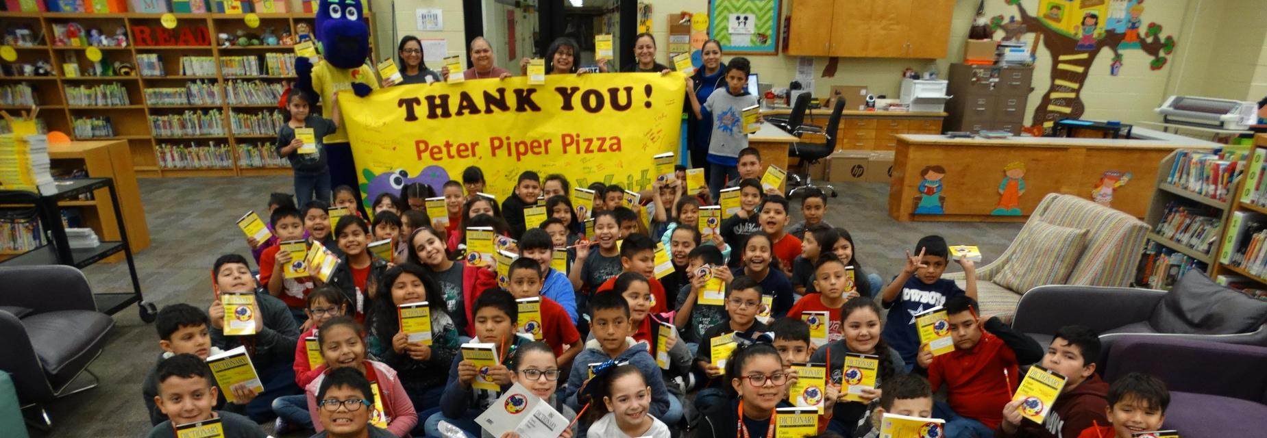 Peter Piper Pizza gifts dictionaries to 3rd graders