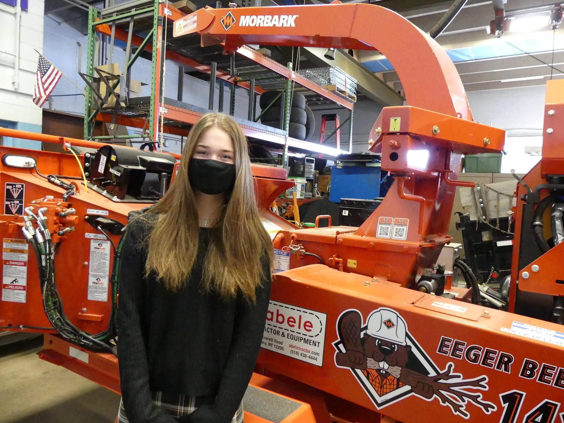 Paulina in front of equipment
