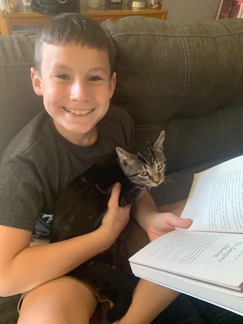 Reading Poppy to a cat