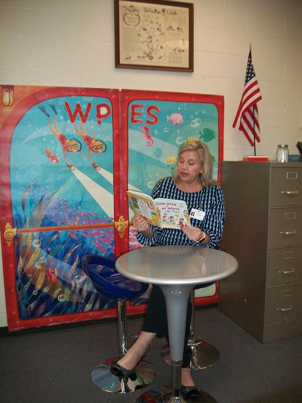 Dr. Lipe reads a book to our students and staff.