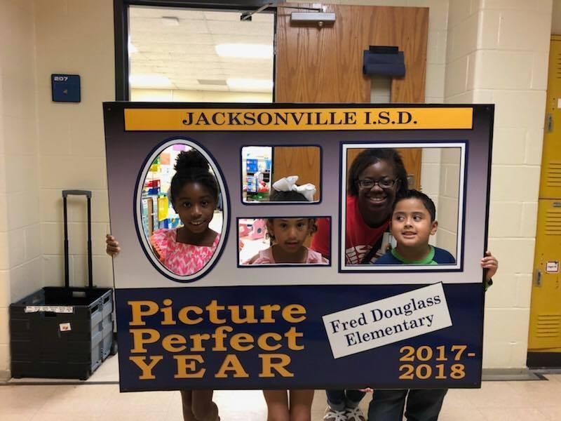 Students posing with the Picture perfect Year sign
