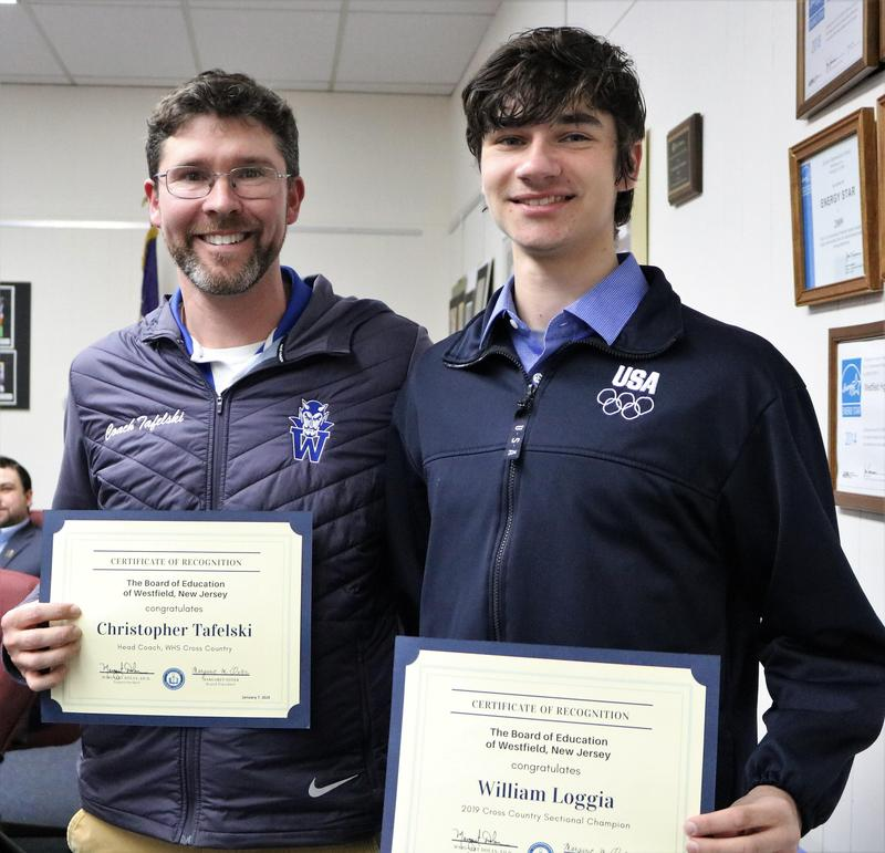 Photo of WHS student athlete and coach honored at Jan 7 Board of Education meeting.