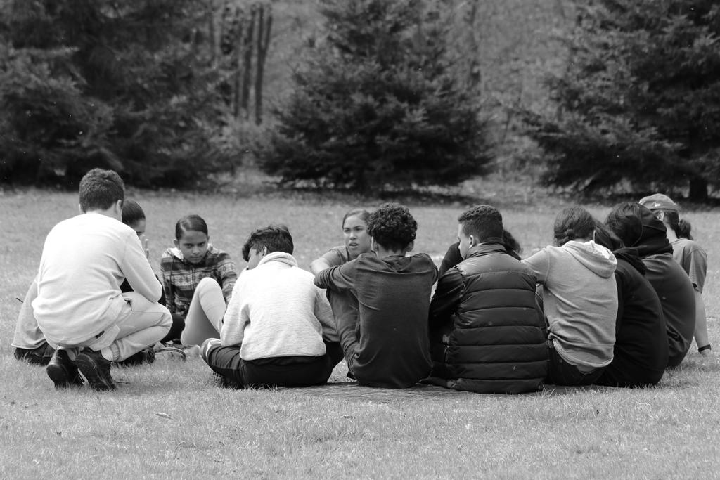 a group of kids sitting in a circle.