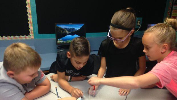 Four students working on science