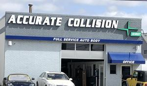 The exterior of Accurate Collision, featuring a large garage door