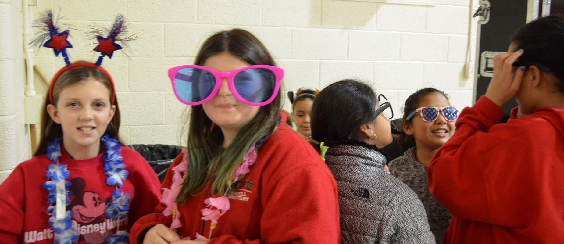 stuents smiling, wearing headbands and sunglasses
