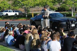 Officer Justin Halgren of the Newhall California Highway Patrol office explains safety measures to the Northlake Elementary School Student Valet Drop-off program members. Courtesy photo.