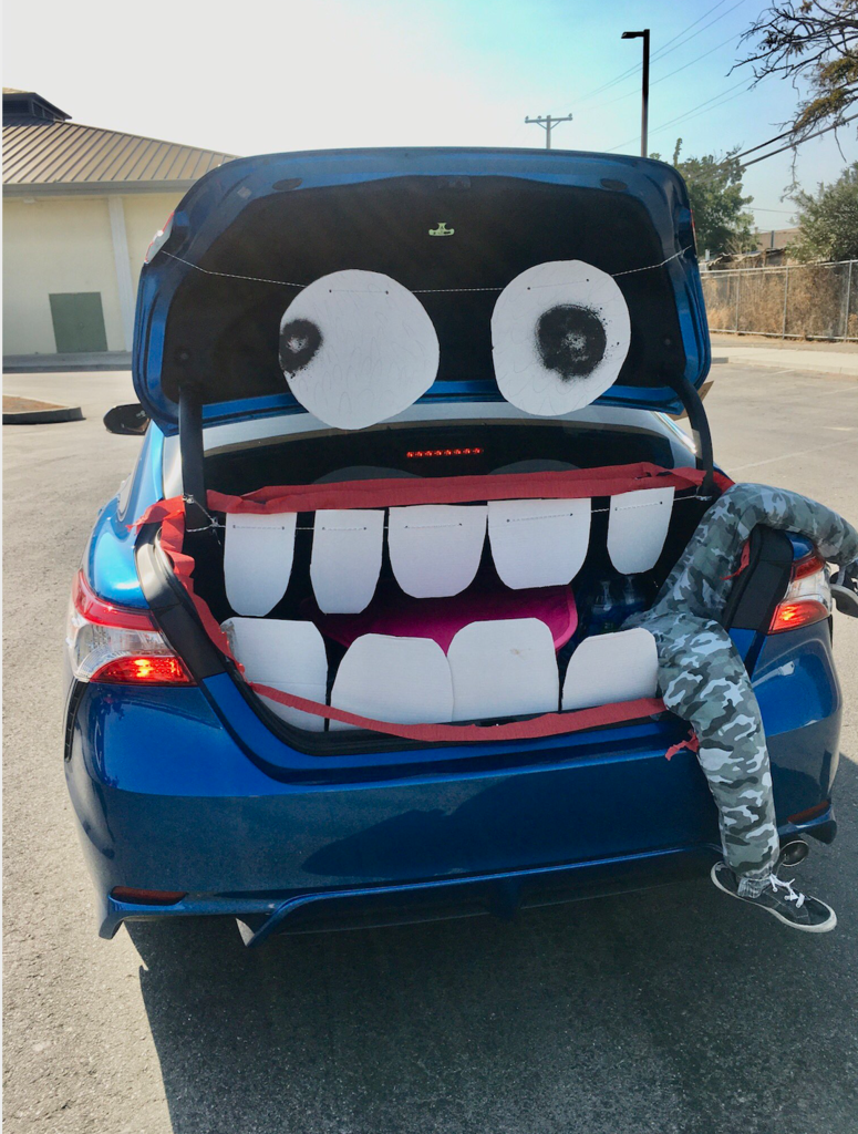 decorated car trunk with mouth shape eating body