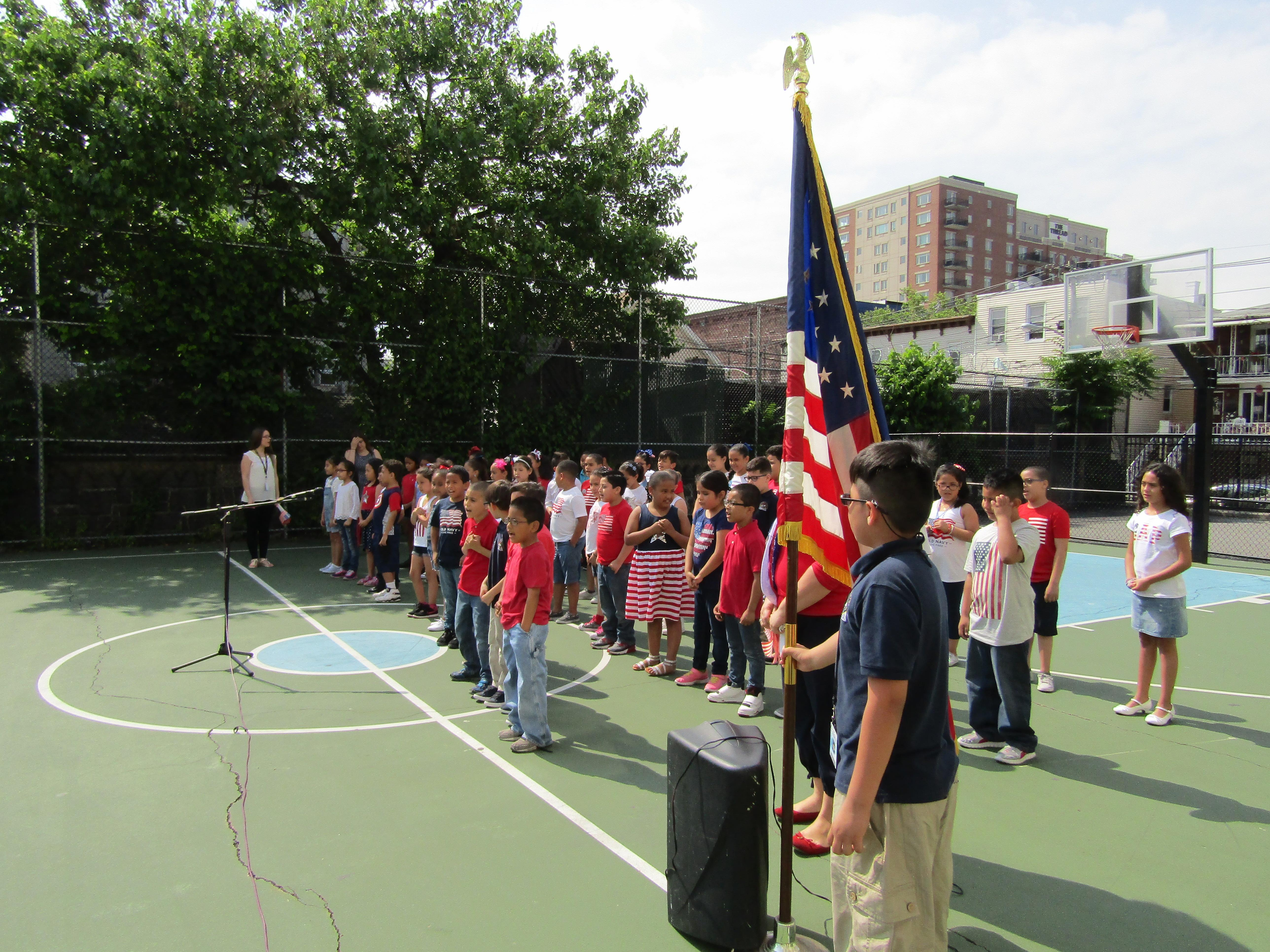 Children at attention saying the pledge