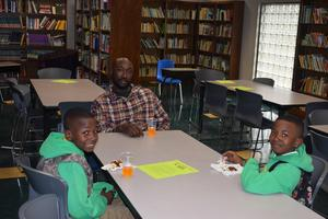 Higgins Middle School host Donuts with Dads.