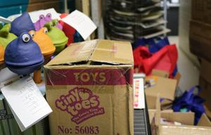 Photo of toys with handwritten student notes to be donated to charity in Newark.
