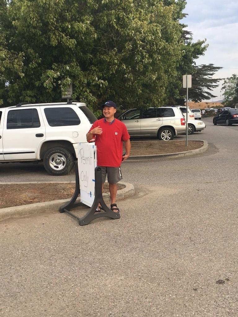 volunteer standing in parking lot