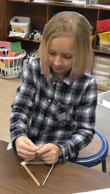 Photo of a Jefferson School 5th grader enjoying makerspace activities in early March.