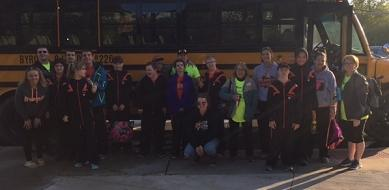 Team and coaches at the send off bus