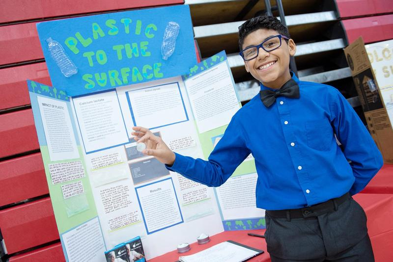 Philip Fonseca displays his project, which earned silver medal honors in the engineering category