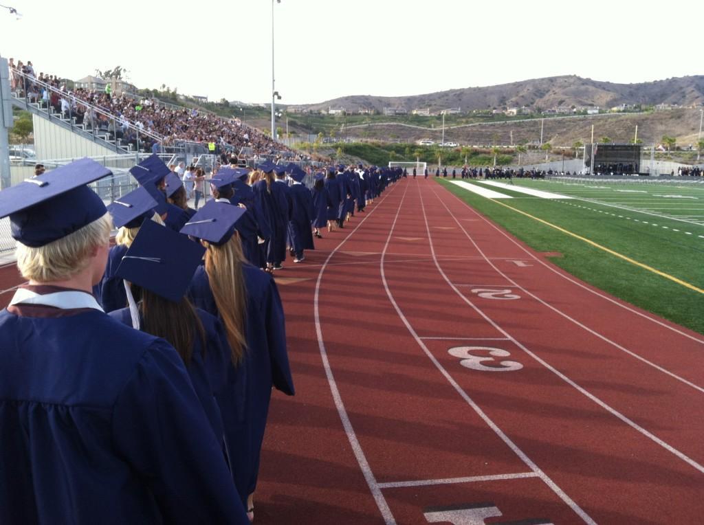 Students entering the stadium for graduation