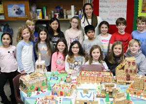Washington 4th graders in Elizabeth Reilly's class participated in a seasonal STEM project in December that combined technology, teamwork, and… gingerbread.