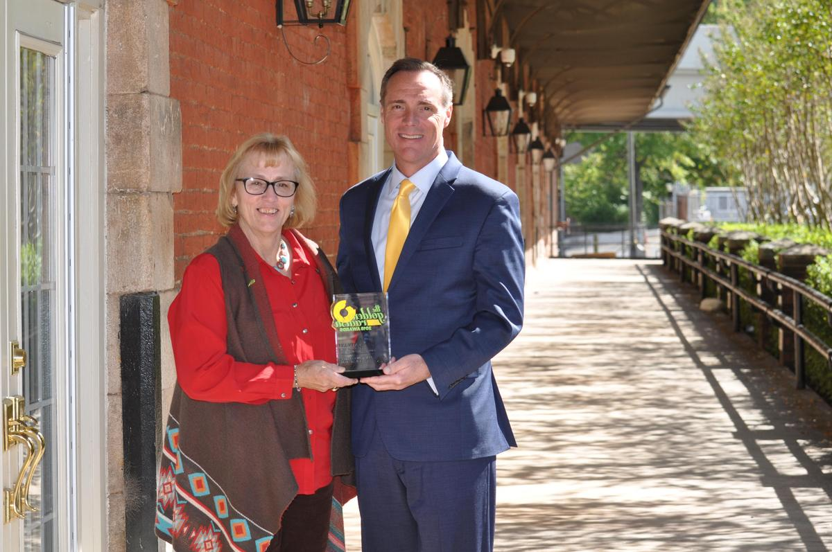 Superintendent Phillip Page and School Nutrition Director Pam Blakeney honored at the 2018 Golden Radish Awards.