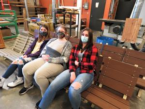 TKHS woods students enjoy the comfortable deck chairs they built and are selling to raise money for the new TKHS mountain bike club.