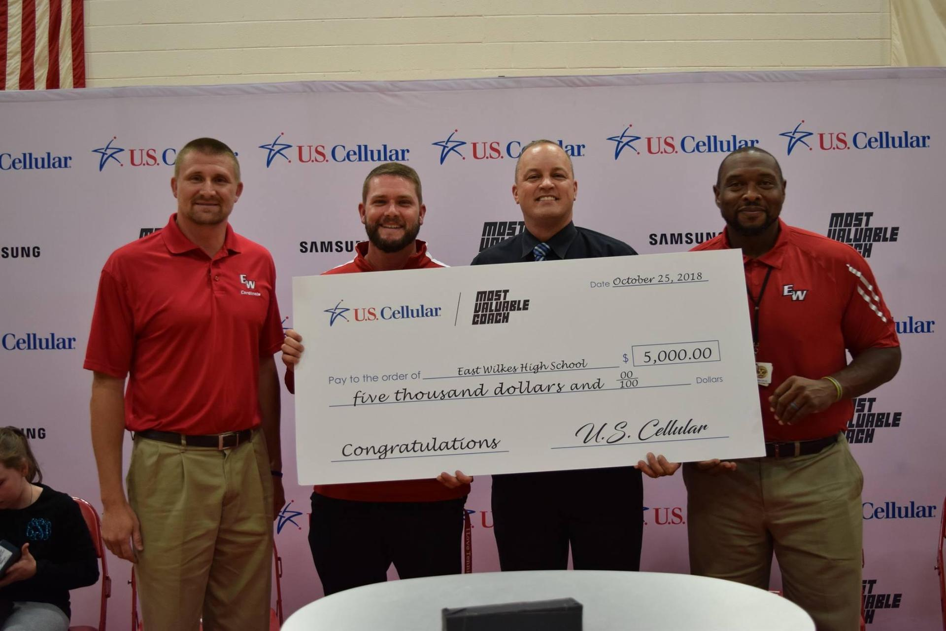 Coach Aaron Simmons accepts $5,000 award for EWHS for making top 15 in U.S. Cellular's Most Valuable Coach Award