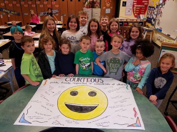 Students smiling behind courteous emoji.