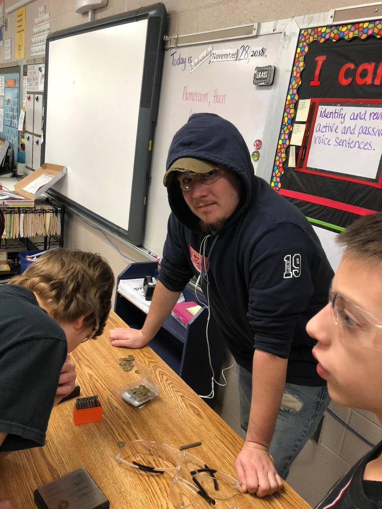 Mechatronics students stamp letters on metal