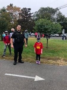 Photo of police officer and student on Walk to School Day